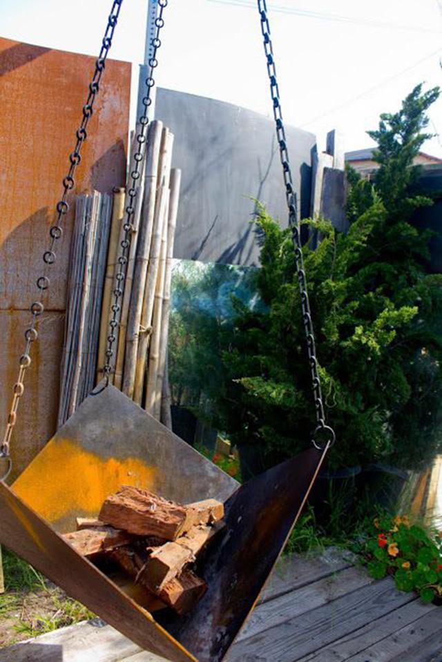 Hanging sheet metal fire pit