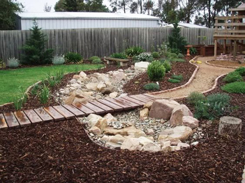 Learn More. For the go-getter in all of us, this dry creek bed landscaping  idea ... - 50 Super Easy Dry Creek Landscaping Ideas You Can Make!