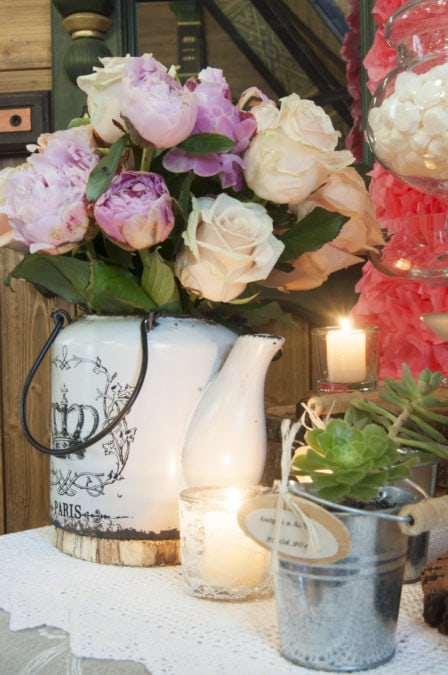 Event party or wedding decoration with candles and flowers in kettle on Provence style