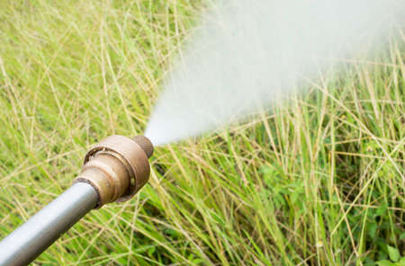 spraying a weed killer