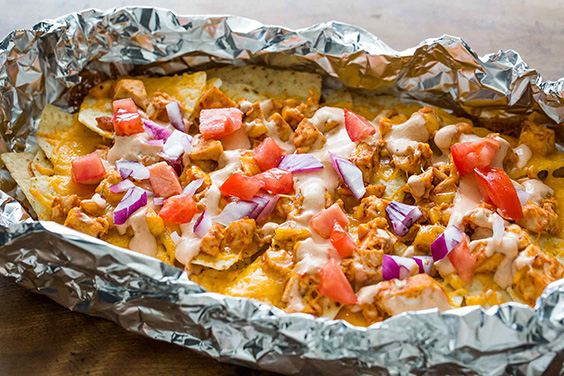 Grilled chicken nachos in foil with sour cream BBQ sauce