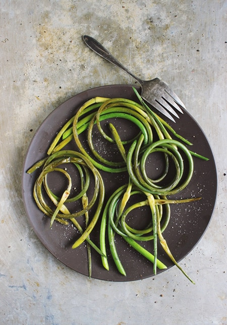 Grilled Garlic Scapes with Black Pepper