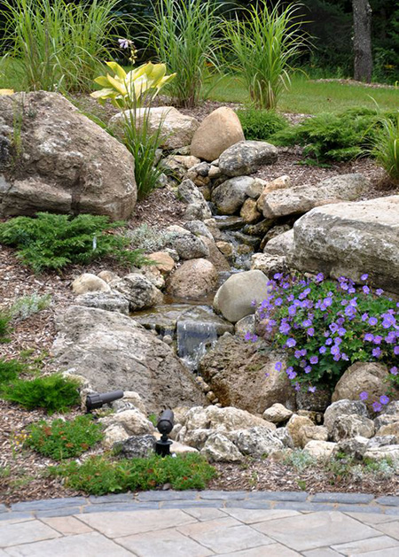 9) Slanted Dry River Bed - 50 Super Easy Dry Creek Landscaping Ideas You Can Make!