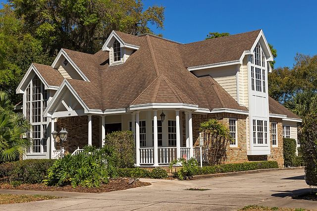 A Graceful Curving, Gabled Porch Completes The Front Architecture Of This  Colonial Meets Contemporary Design. Narrow Columns Complement The Long  Windows To ...