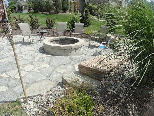 Charming Flagstone Designs #2: Stacked Stone Garden Edging | Brown  Flagstone Garden Patio With Moss Rock Border  Under Construction
