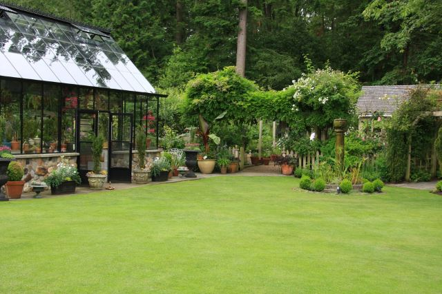 Beautiful greenhouse in an upscale garden.