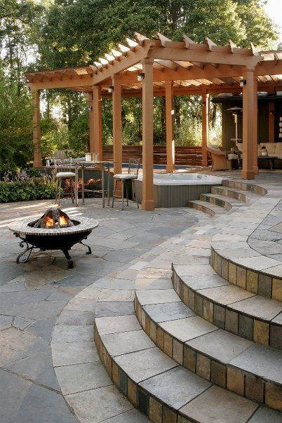 Although this design mostly allows for an open hot tub exposure, the pergola  design keeps off the worst of the sunshine, and also helps infringe lighter  ... - 31 Awesome Hot Tub Enclosure Ideas: #22 Is The Coolest Ever!