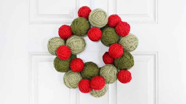Beautiful Knitted Wreath Balls On A White Painted Door