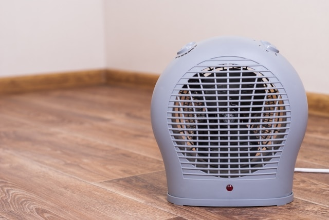 Portable electric heater fan type is on the floor