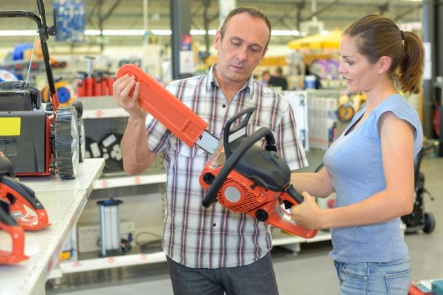 woman choosing chainsaw