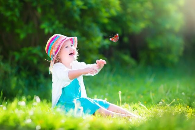 Girl playing with the butterfly