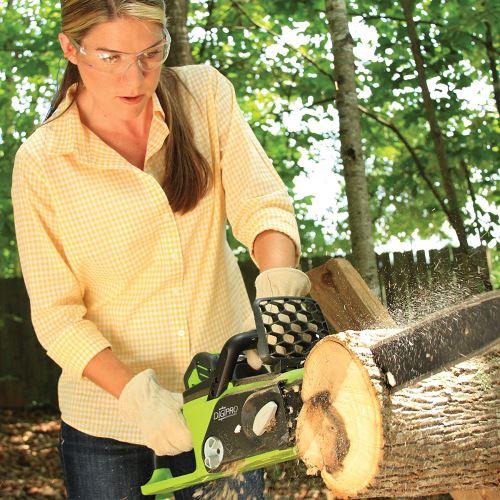 Woman cutting wood using log splitter