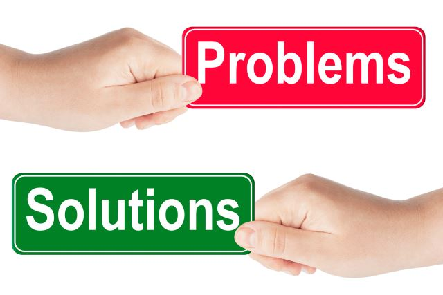 Problems and Solutions traffic sign in the hand on the white background