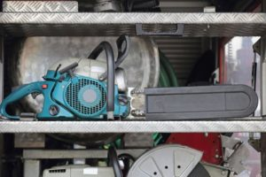 Petrol Powered Chainsaw at Shelf in Fire Truck