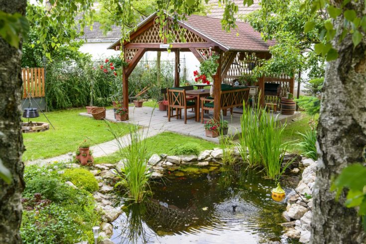 Beautiful Garden With A Little Pond And Backyard Terrace To Relax