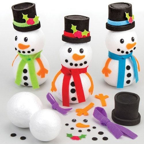 Three decorative small snow men with colorful ties and a black hat