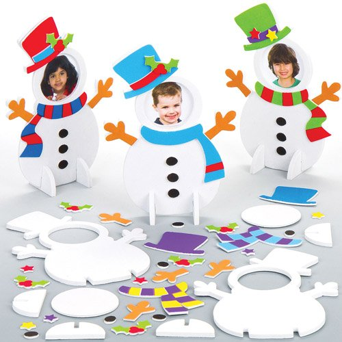 Three snowman assembled with faces on its head and several pieces laid down