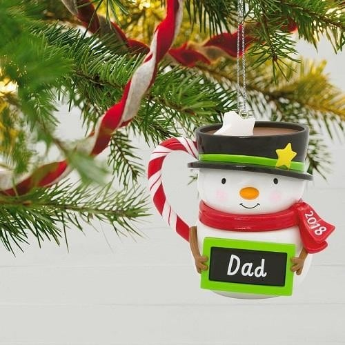 Christmas tree decor little snowman holding a black framed with green with a writing Dad
