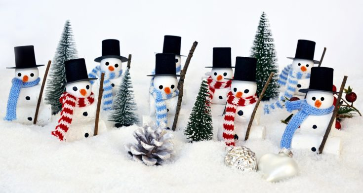 Several DIY Snowman wearing little hats and scarfs with several cute little christmas tree and pinecone