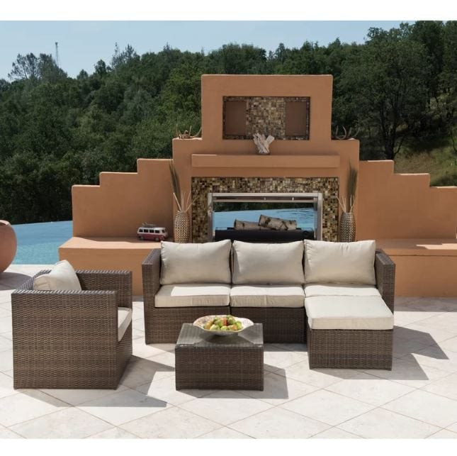 Rattan set with cushions overlooking trees and lake