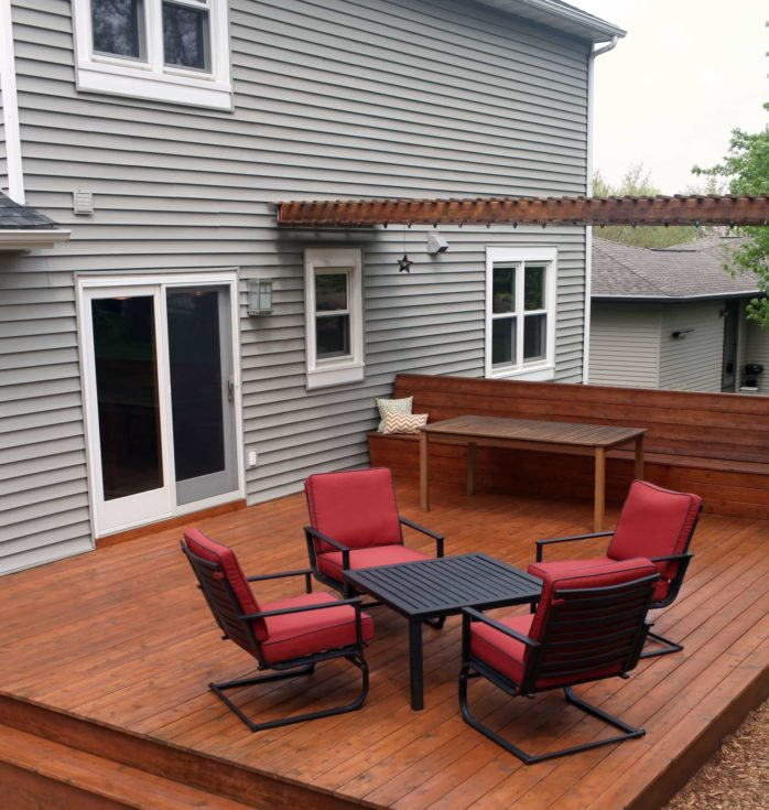 Deck view of a luxury house with bonding area of furnitures