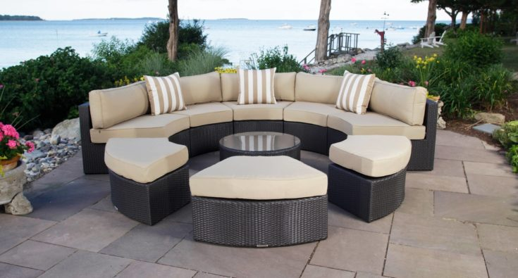 Rounded rattan with cushions with overlooking sea on the background