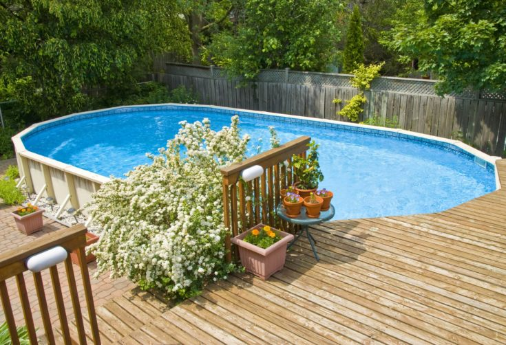 Wooden fenced backyard with modern and personalized swimming pool
