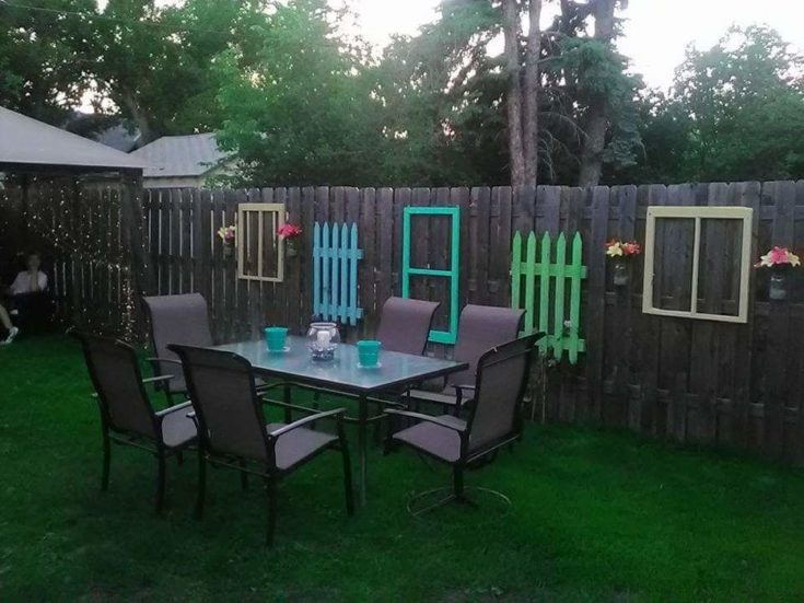 Dining furniture set near the fence with several DIY wooden design