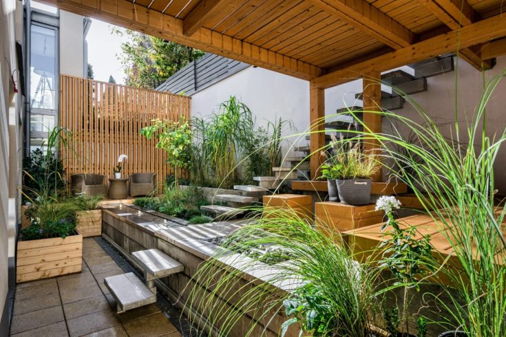 Indoor garden under the deck with a wooden staircase