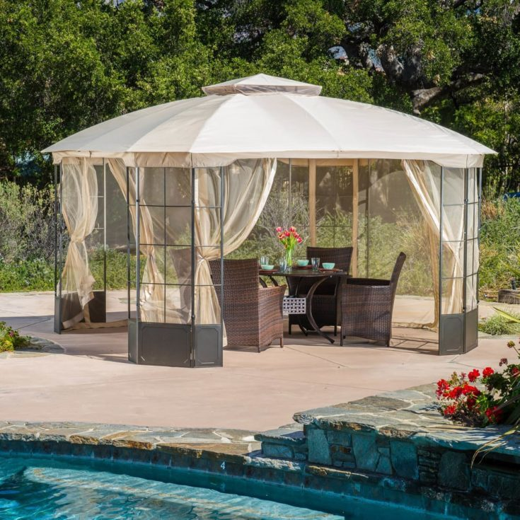 Outdoor steel gazebo with cover on a stoned walking area beside the swimming pool