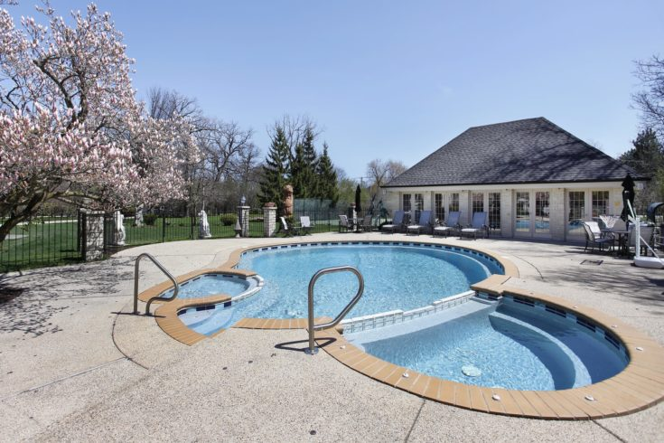 Outdoor swimming pool with attached sauna