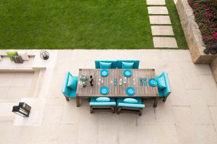 elegant table and chairs on empty ground near meadow on top view