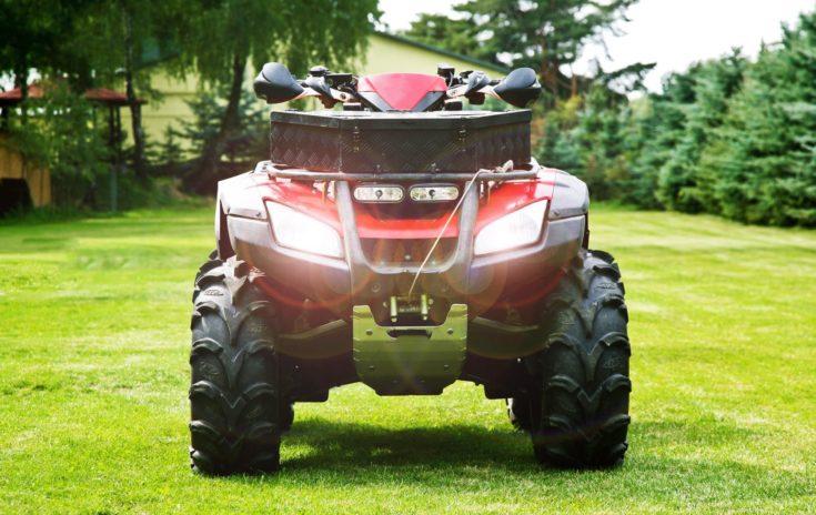 ATV ( All Terrain Vehicle ) - Quad Bike on the Back Yard. Headlights On. Front Shot