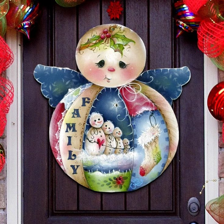 Angelic themed door hanging with several snowman on its body design