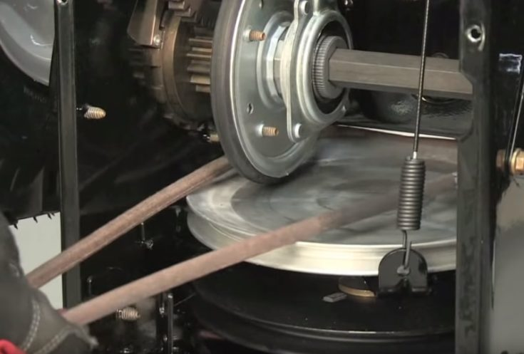 Drive belt slip off to friction wheel disc and work in between friction wheel and disc. Remove it from the snow thrower.