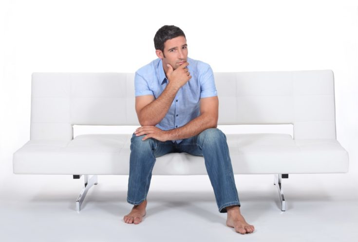 Man sitting on a sofa