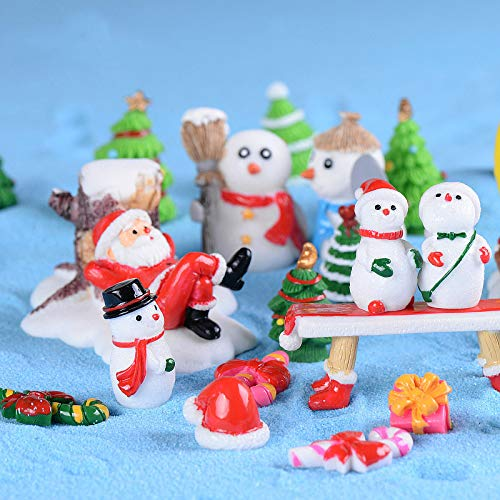 Miniature santa toy relaxing on the center surrounded by several snowman with different dress decorations