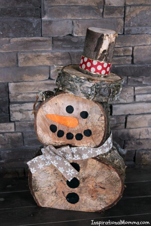 DIY chopped logs placed on top of each other adorned and decorated to make it look like a snowman