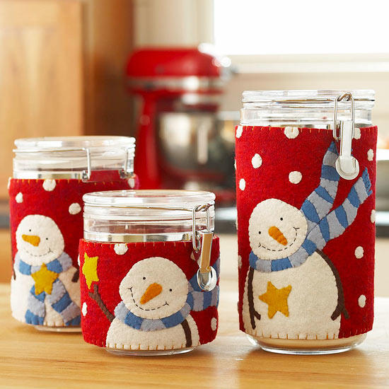 Three jars adorned its body with clothings that has smiling snowman as its design
