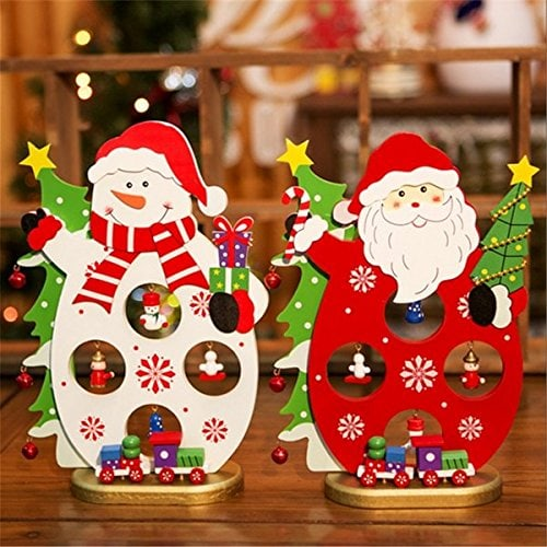 Santa and Snowman side by side with several Christmas related decorations standing on a wooden platform