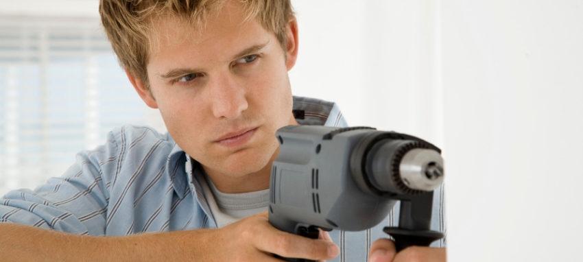 Man holding nail gun