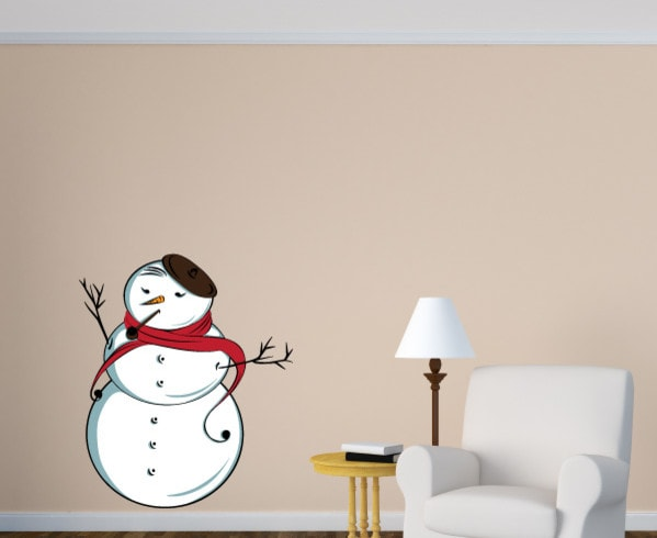 Graceful snowman vinyl decal on a wall with cushion chair, table and lampstand