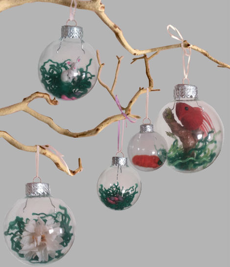 Christmas tree transparent balls hanging on twigs with artificial plants inside
