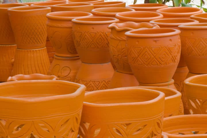 A lot of tree pots made of clay with engraving on its body as design