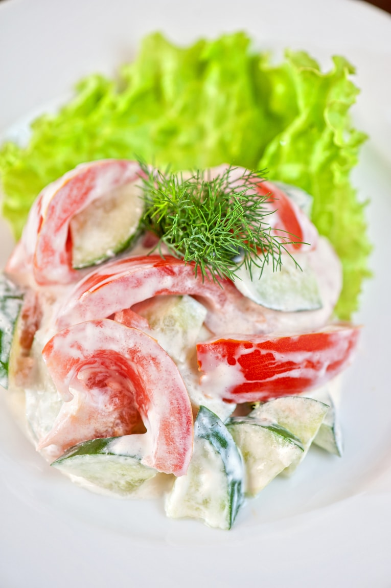 Salad from cucumber tomato and sour cream