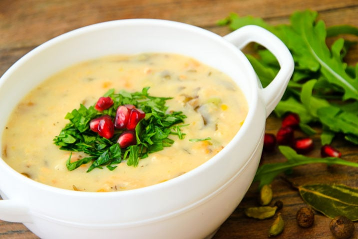 Healthy and Diet Food: Soup of Chowder with Pomegranate. Studio Photo