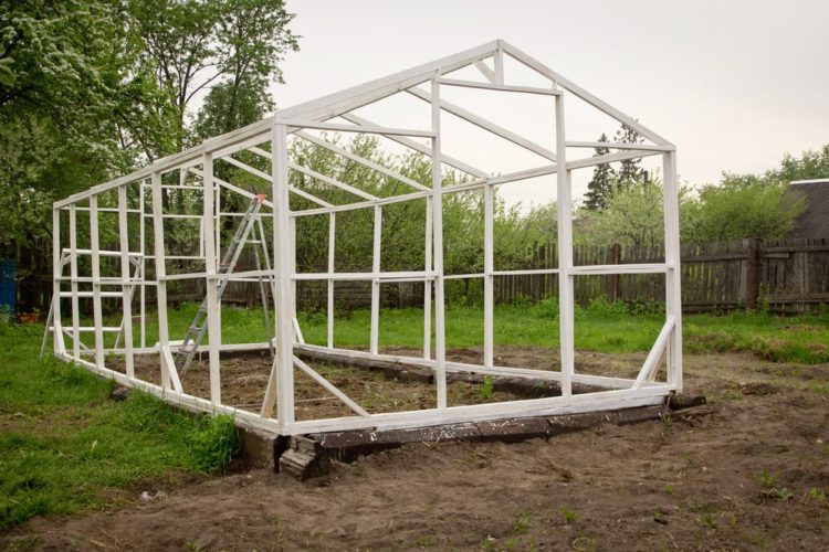 Construction of a small greenhouse in a garden
