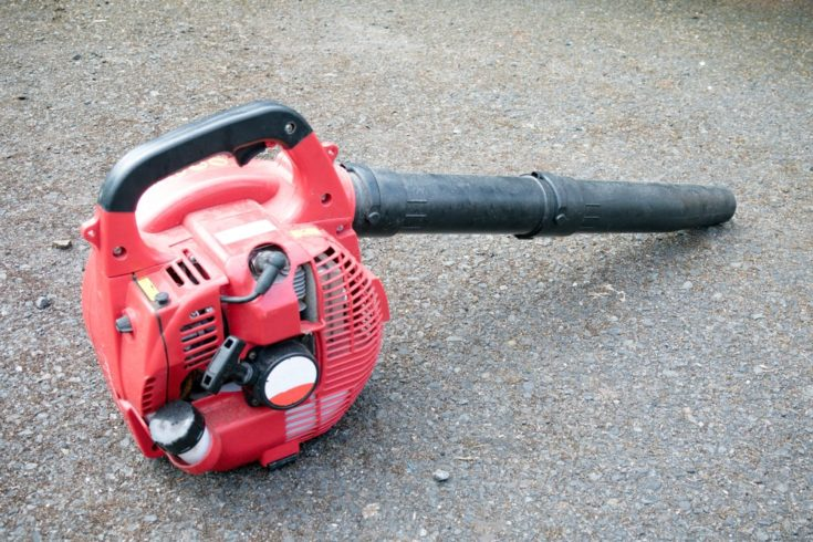 A petrol leaf blower for clearing large amounts of fallen leaves