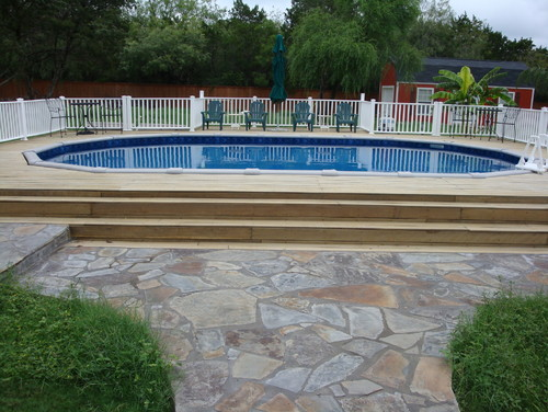 nice pool walkway with stone and grass