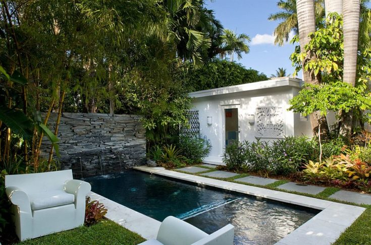 Backyard swimming pool with sofa on the side and shades of tree
